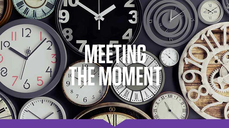 Meeting the Moment: A collection of clocks are laid out on display, each displaying the time as 10:10.