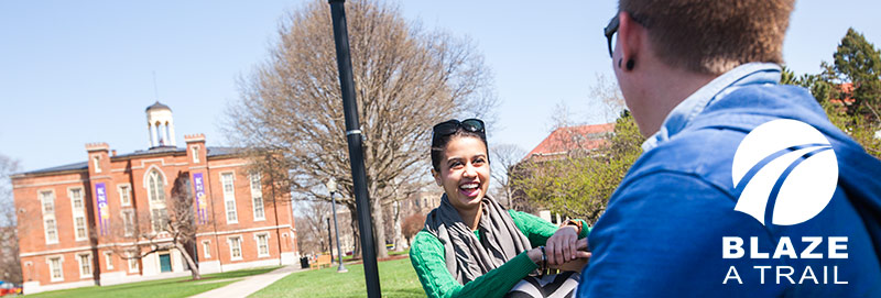Students enjoy a sunny spring day on the lawn south of Knox College's Old Main