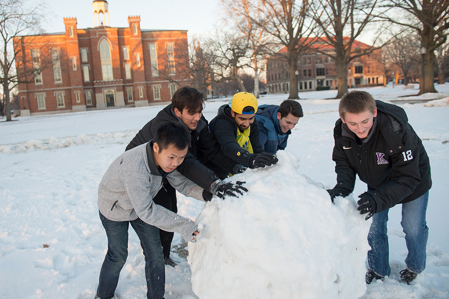 Students build a snowman on the South Lawn of Old Main.