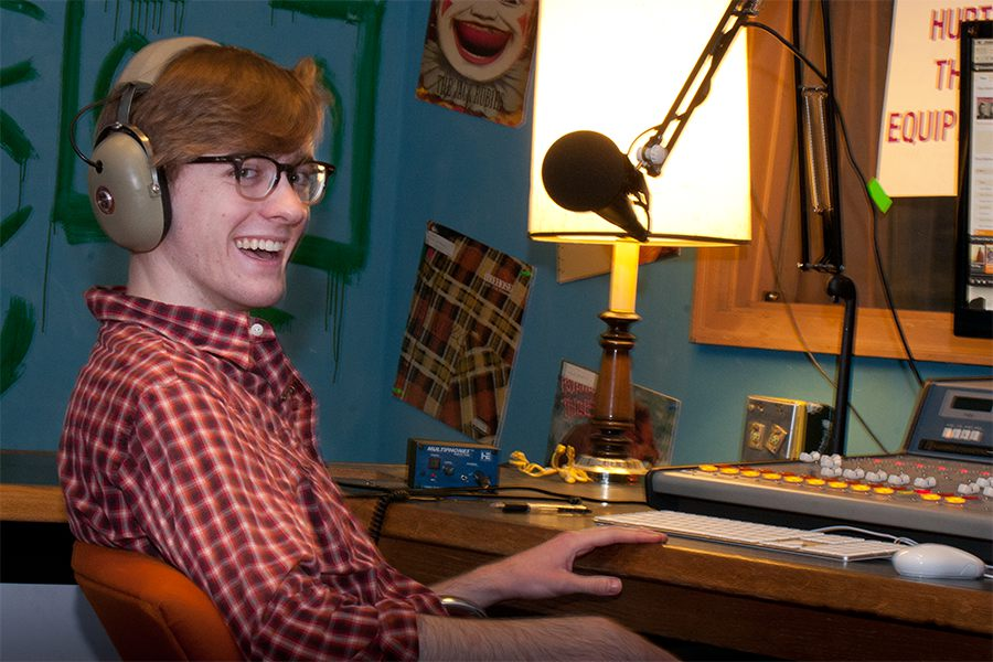 Student Christopher Poore in studio of campus radio station WVKC