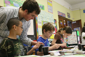 A Knox College student works with students at a Galesburg elementary school.