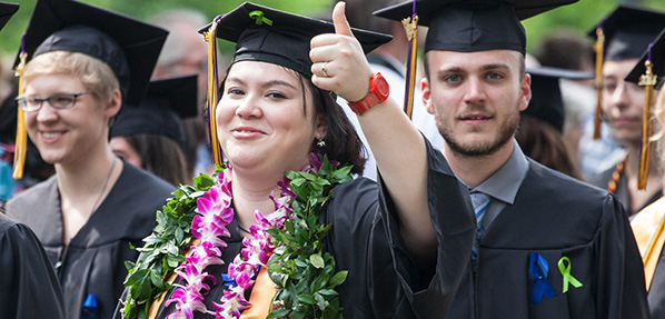 Students wear green ribbons at Commencement 2014