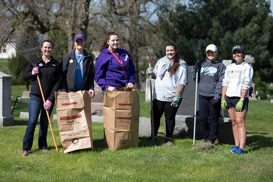 Students volunteer to restore Hope Cemetery for Knox College's Day of Service.