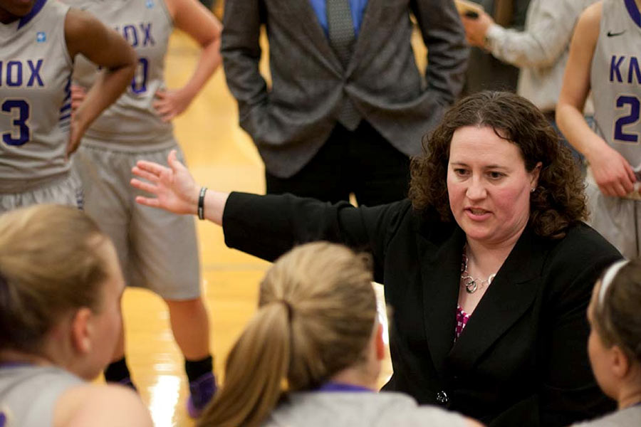 Women's Basketball Coach Emily Cline mentors her team from the sidelines.
