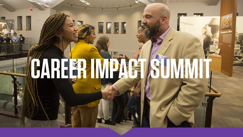 A student and alumnus shake hands at the 2019 Knox College Career Impact Summit