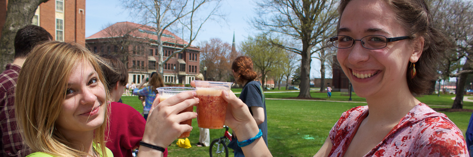 Students sample organic juices at the annual Earth Week Festival.