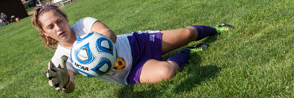 Women's soccer goalie in pre-season practice.