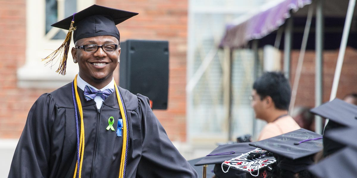 A student smiles during the 2014 Knox College Commencement ceremony.