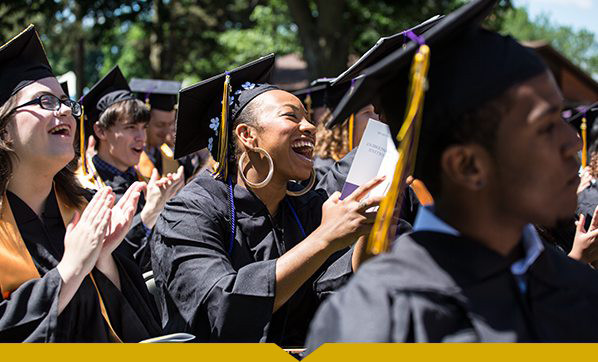 Graduates laughing during Commencement 2016