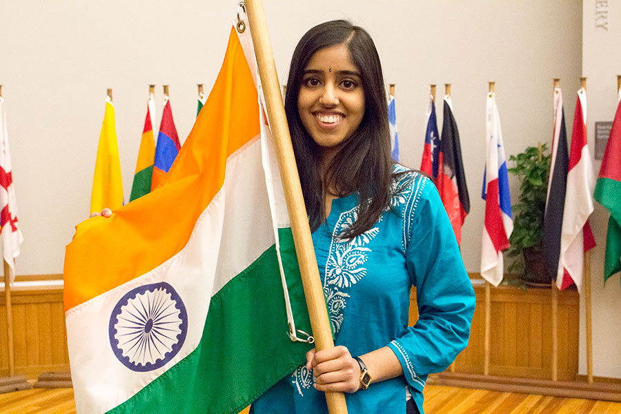 Sruthi Doniparthi '16 poses with her flag at International Fair photo session.