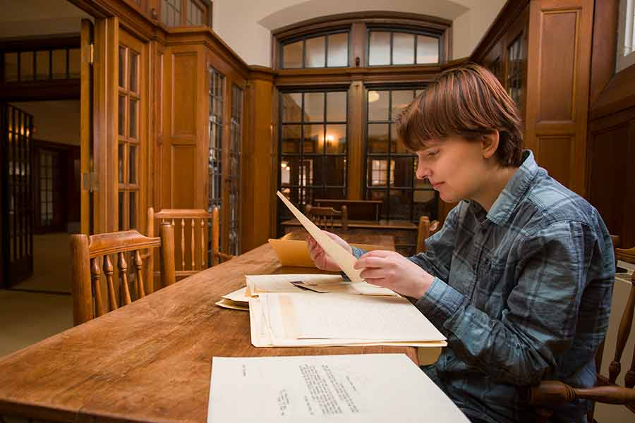 Honors student Sarah Pawlicki reads over archival material in Seymour Library.