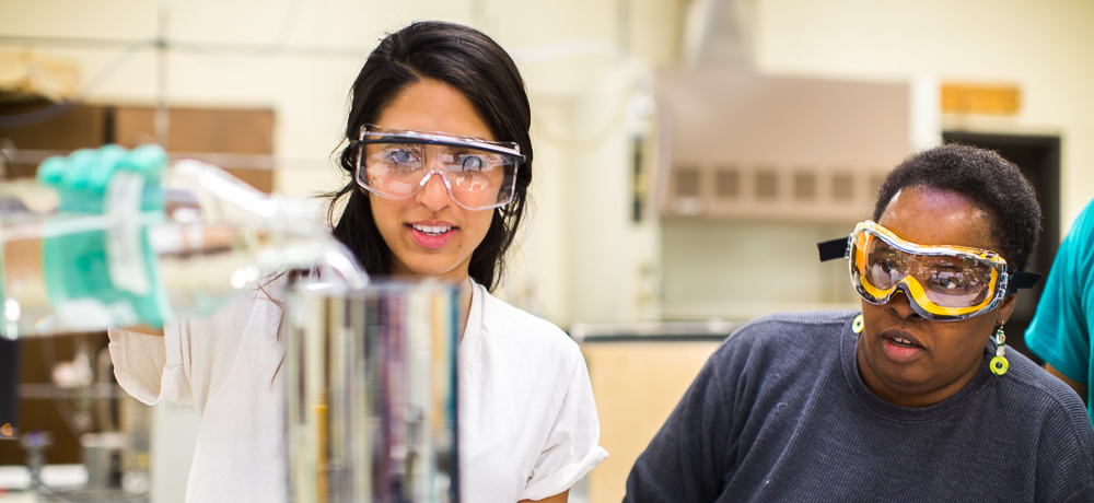 Shelly Bhanot and professor Mary Crawford work on a project in a chemistry lab.