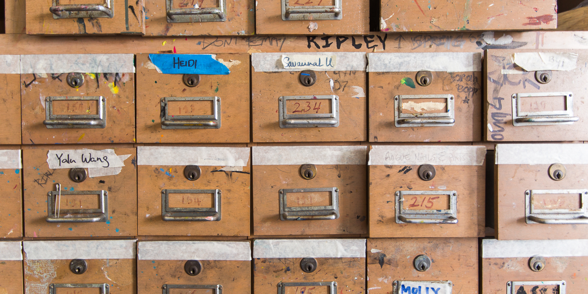 Drawers hold art supplies for students in a painting class.