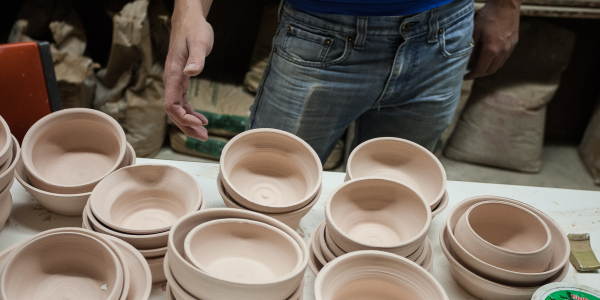 Stacks of ceramic bowls created by students in the ceramics studio.