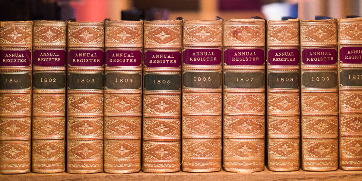 Annual Register's on a shelf in Seymour Library.