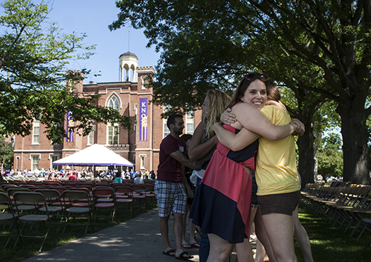 Students embrace during senior Pumphandle at Knox College.