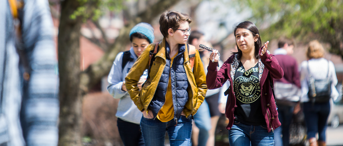 Students walking to class on a spring day.
