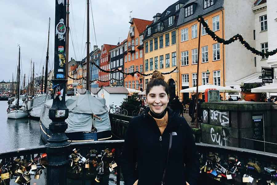 Student Kira Carney in front of famous tourist spot in Denmark while studying abroad.