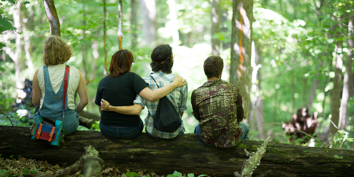 Students gather in the forest at Green Oaks, to view art proejcts during Green Oaks Term.