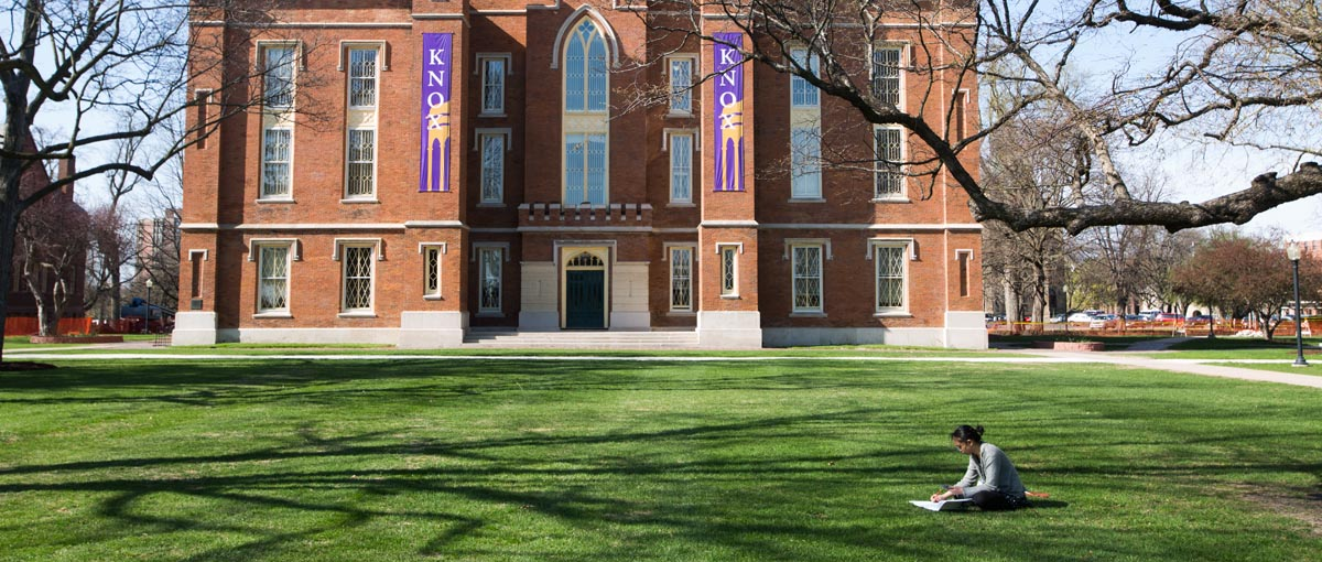 Student in front of Old Main