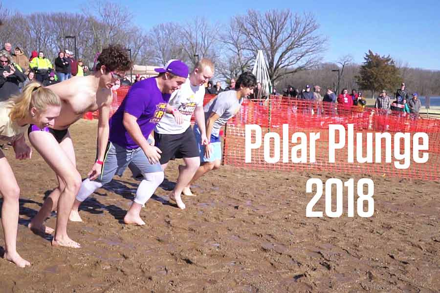 Knox College Students get ready to run into the chilly water during the annual Polar Plunge.