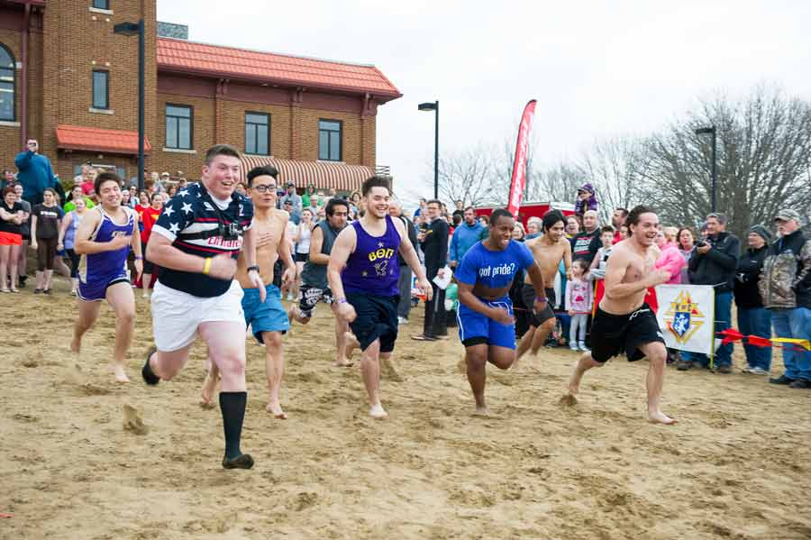 Members of Beta Theta Pi run into the water as part of the Special Olympics Illinois Polar Plunge.