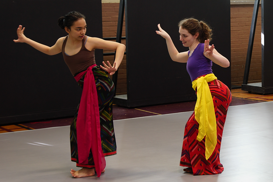Diandra Soemardi, left, teaches another student a Balinese Dance in the Auxiliary Gym.