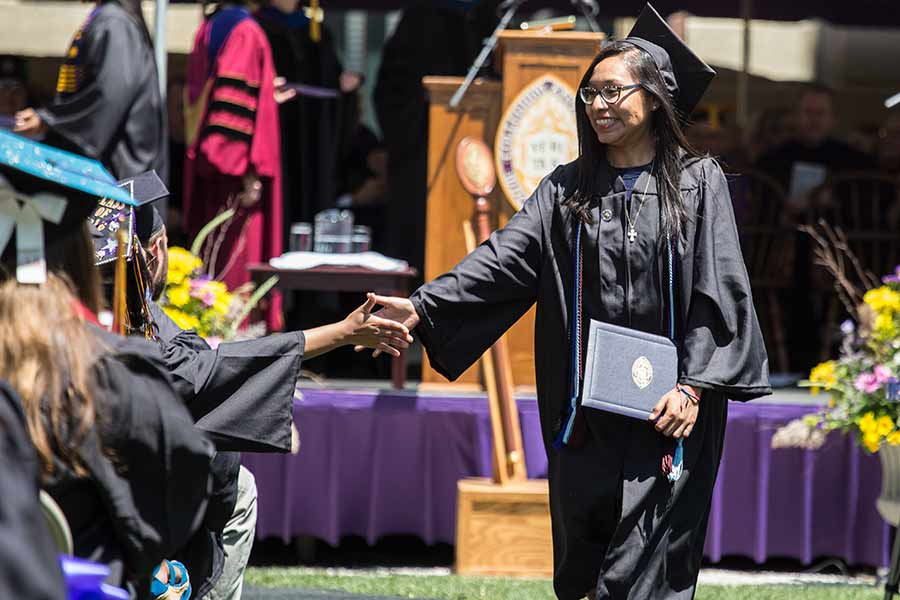 A 2016 graduate enjoys the moment at Knox College Commencement.