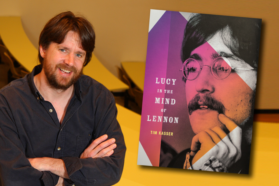 Psychology professor Tim Kasser with his book on John Lennon.