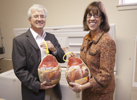 Mauri Ditzler and Teresa Amott donate turkeys to a food pantry