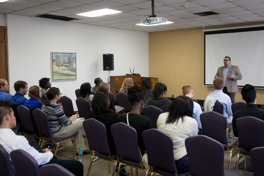 Students listen to a presentation given by Greg Lardi '02 during Knox College's 2014 Career Impact Summit.