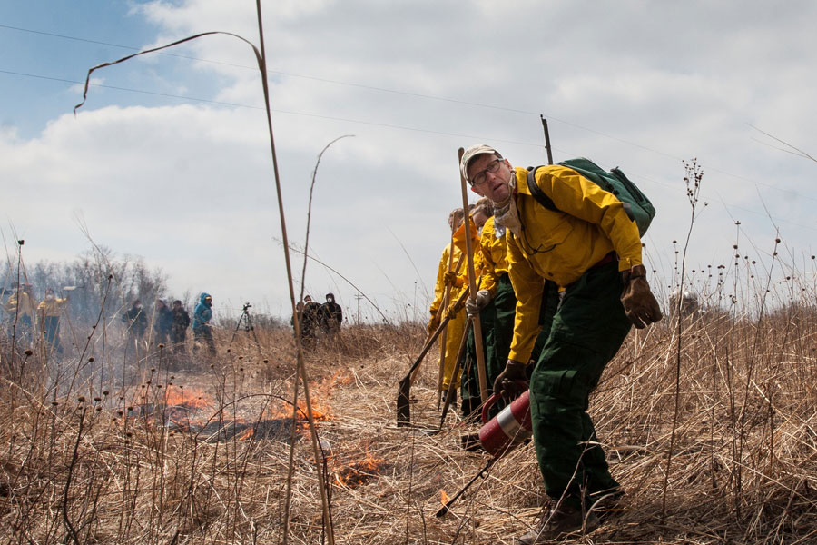 Professor Stuart Allison leads Knox students in the 2014 Prairie Burn at Green Oaks.