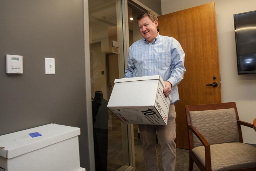 Dean of Admission Paul Steenis moves into a new office in Knox College's Alumni Hall.