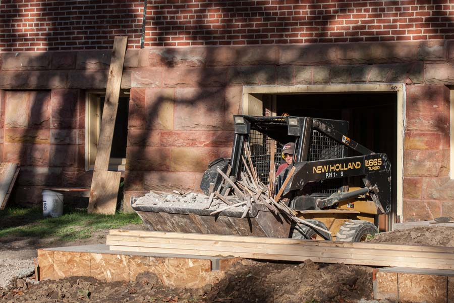 Construction waste removal during Alumni Hall renovation.