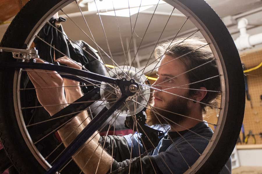 Knox College student working in campus bike shop