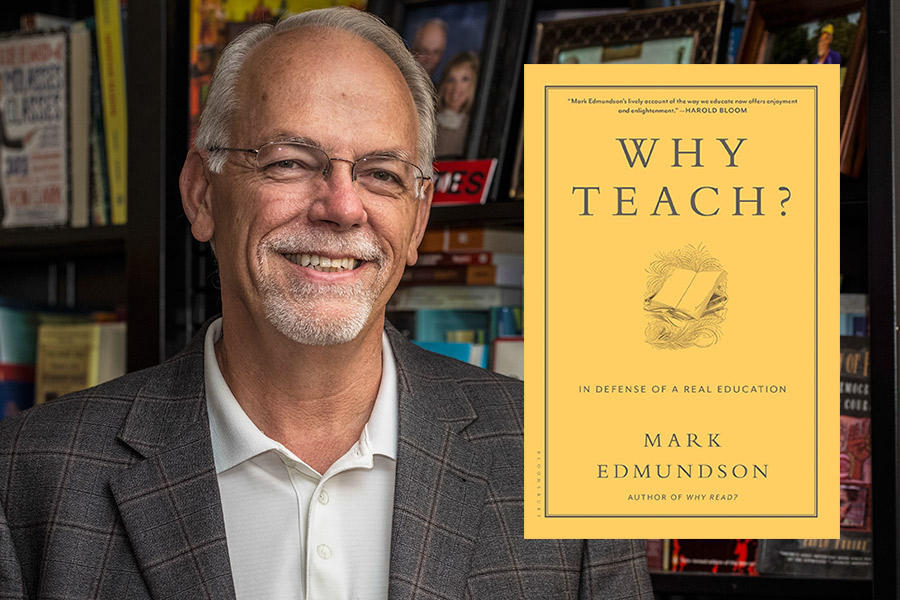 Joel Estes smiles next to the book Why Teach?