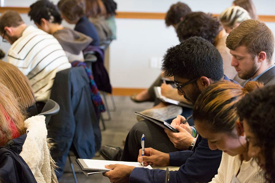 Students take notes at the Career Impact Summit.
