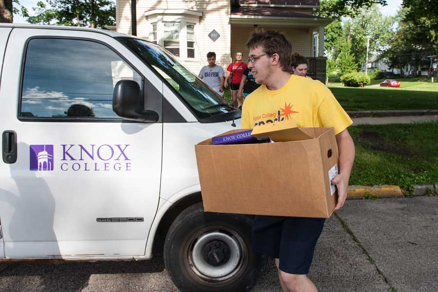 Knox College students collecting items from residence halls for reuse and recycling.