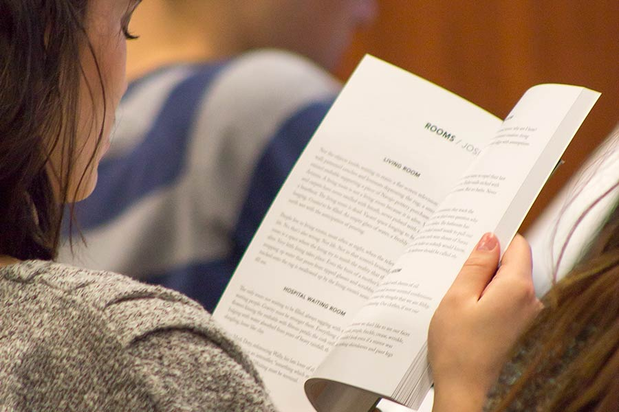 A Knox student looks over the latest issue of Catch, Knox's literary journal.