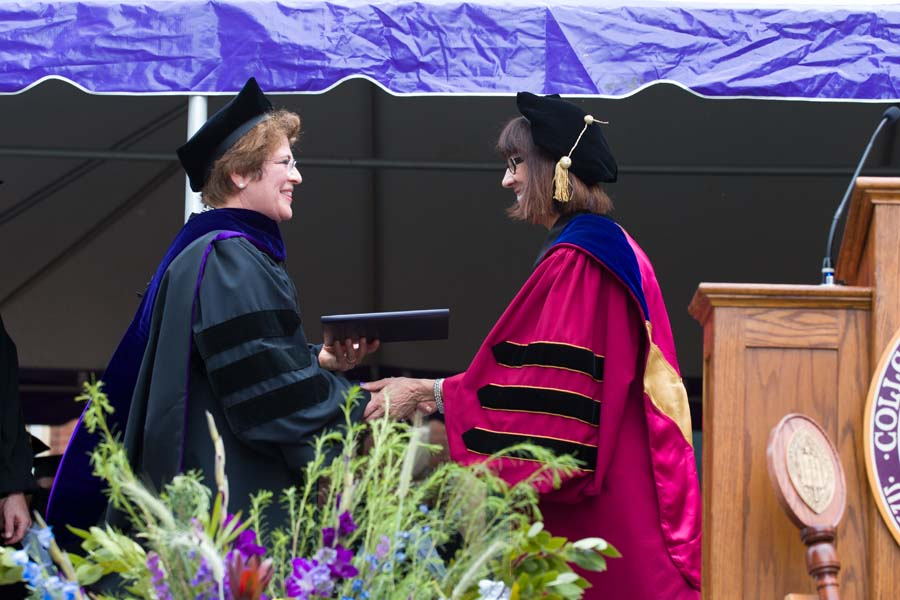 Ambassador Fay Hartog-Levin is awarded an honorary degree by Teresa Amott, president of Knox College.