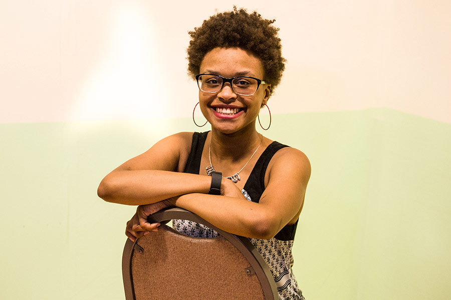 "Deja Jenkins, in Studio Theatre, with walls from the set of the play she wrote, ""Matter of Life and Maybe death."""