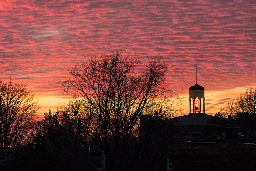 A dramatic sunset over Knox College's Old Main.