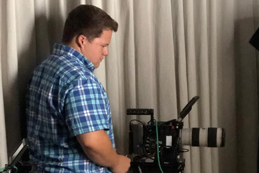 Jordan runs camera during production work.