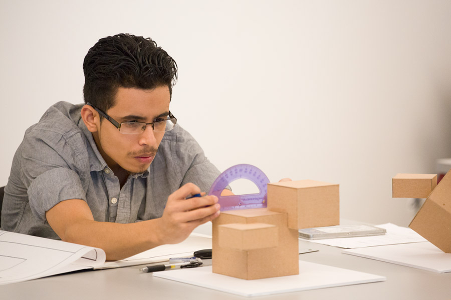 Student works on architectural models