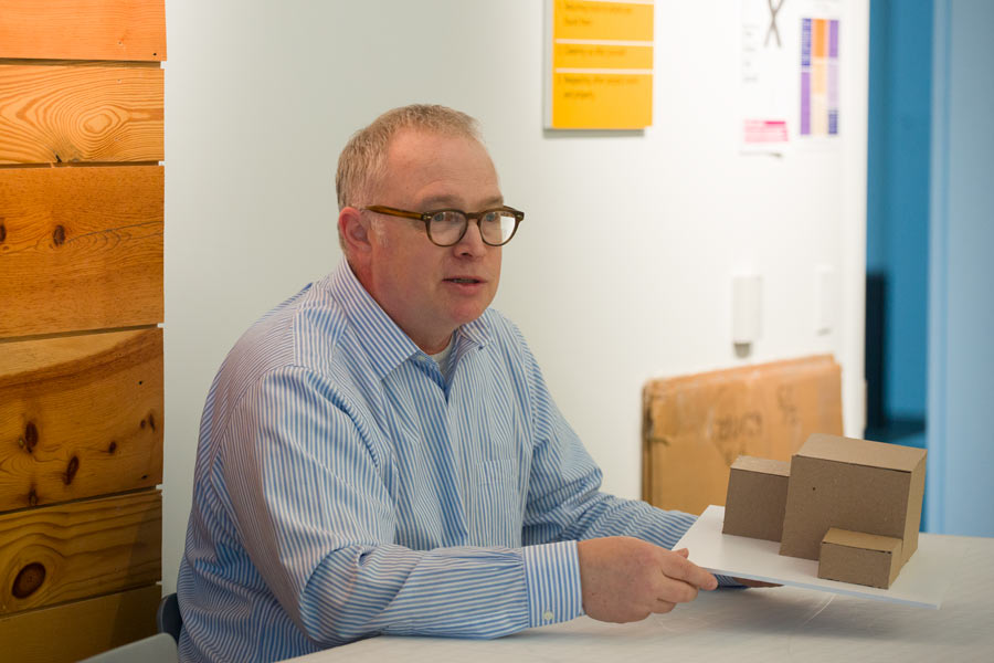 Jim Harriman '82 offers advice to students as they work on their model construction