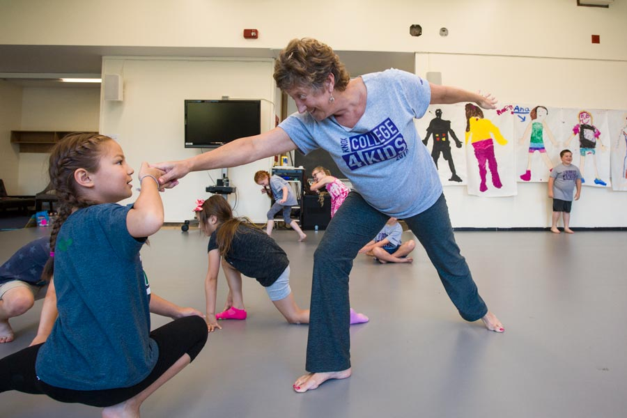 Kathleen Ridlon, director of the Kleine Center for Community Service, leads a dance lesson with the Junior Program of College for Kids.
