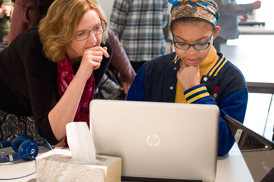 Professor Monica McGill works with a student on her project.