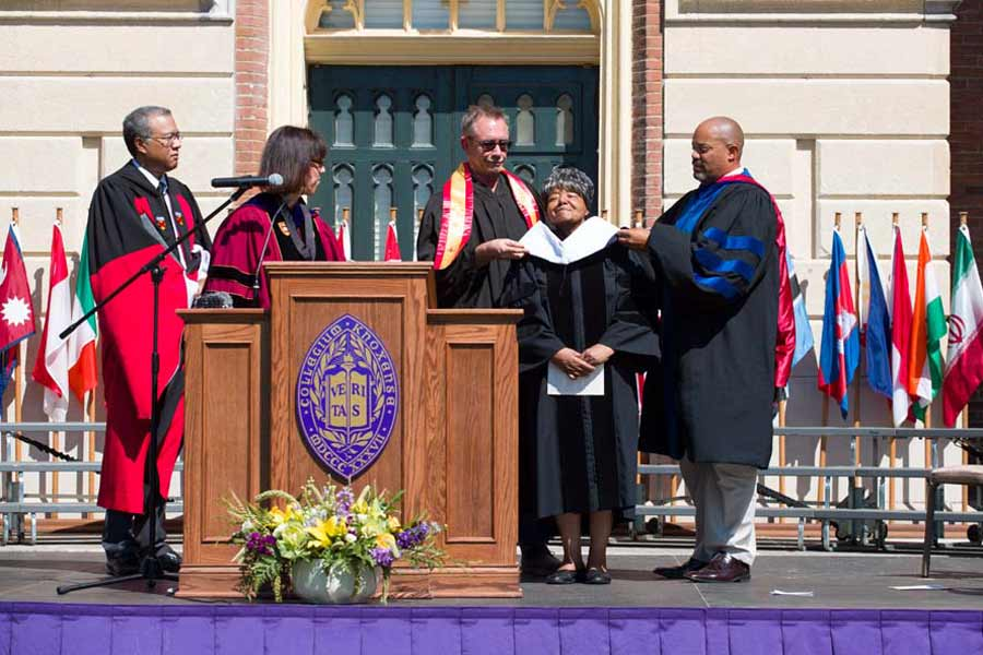 As part of Opening Convocation 2018, President Teresa Amott confers an honorary degree on Elizabeth Eckford '63, who presented the Convocation Address.
