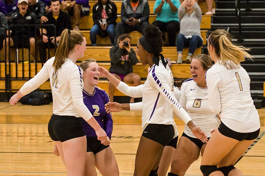 Prairie Fire volleyball celebrates.