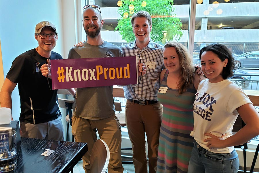 Alumni guests at one of 14 #KnoxProud Day events on June 13 display a #KnoxProud banner.